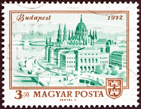 magyar posta: HUNGARY - CIRCA 1972  A stamp printed in Hungary issued for the centenary of unification of Buda, Obuda and Pest as Budapest shows Parliament Building, Budapest, circa 1972