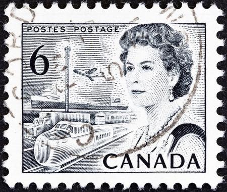 canada stamp: CANADA - CIRCA 1967  A stamp printed in Canada shows Queen Elizabeth II and transportation, circa 1967