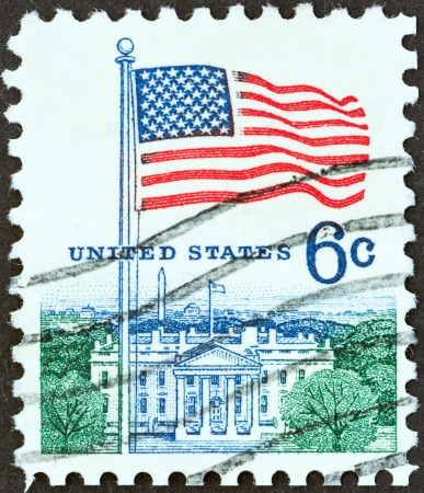 u s  flag: USA - CIRCA 1968  A stamp printed in USA from the  Flag  issue shows U S  flag and the White House, circa 1968
