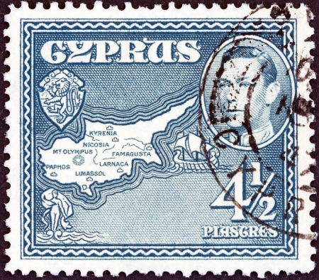 kypros: CYPRUS - CIRCA 1938  A stamp printed in Cyprus shows Map of Cyprus, circa 1938   Editorial