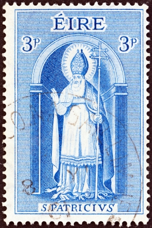 patron saint of ireland: IRELAND - CIRCA 1961  A stamp printed in Ireland issued for the 15th death centenary of St  Patrick shows Saint Patrick, circa 1961   Editorial
