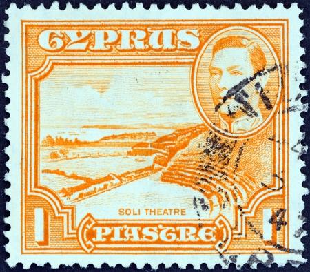 kibris: CYPRUS - CIRCA 1938  A stamp printed in Cyprus shows Roman theatre, Soli and King George VI, circa 1938   Editorial