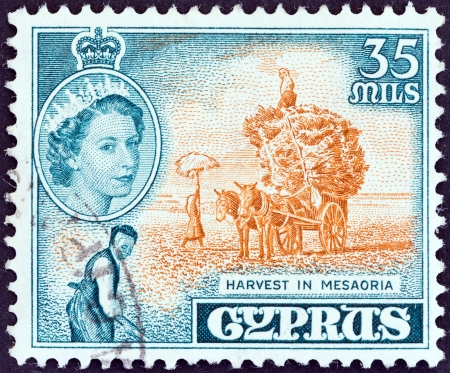 kypros: CYPRUS - CIRCA 1955  A stamp printed in Cyprus shows harvest in Mesaoria and Queen Elizabeth II, circa 1955   Editorial