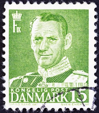 ix portrait: DENMARK - CIRCA 1948  A stamp printed in Denmark shows King Frederick IX, circa 1948