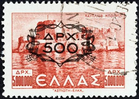 bourtzi: GREECE - CIRCA 1946  A stamp printed in Greece shows Bourtzi fortress, Nafplion  500 drachmas overprint , circa 1946   Editorial