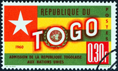 un used: TOGO - CIRCA 1961  A stamp printed in Togo issued for the Admission of Togo into U N shows Togo Flag, circa 1961