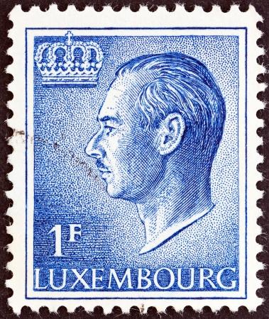 sello: LUXEMBOURG - CIRCA 1965  A stamp printed in Luxembourg shows a portrait of Grand Duke Jean, circa 1965   Editorial