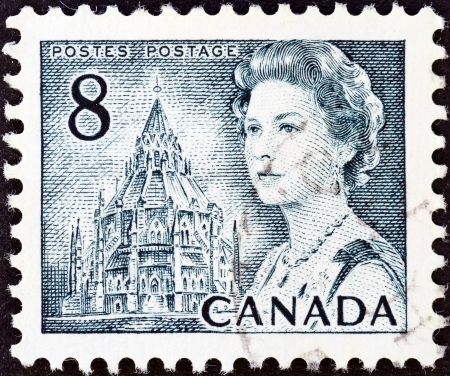 CANADA - CIRCA 1967  A stamp printed in Canada shows Queen Elizabeth II and Library of Parliament, circa 1967