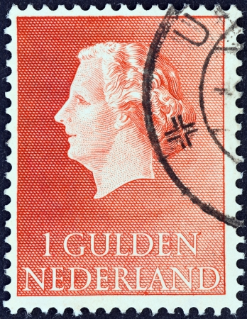 gulden: NETHERLANDS - CIRCA 1953  A stamp printed in the Netherlands shows Queen Juliana, circa 1953   Editorial