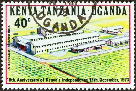 nandi: KENYA UGANDA TANGANYIKA - CIRCA 1973  A stamp printed in Kenya Uganda Tanganyika issued for the 10th anniversary of Kenya s independence shows Tea Factory at Nandi Hills, circa 1973  Editorial