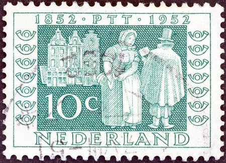 posthorn: NETHERLANDS - CIRCA 1952  A stamp printed in the Netherlands from the  Netherlands Stamp Centenary and Centenary of Telegraph Service  issue shows Postman delivering letters, 1852, circa 1952