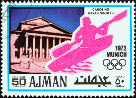 stempeln: AJMAN EMIRATE - CIRCA 1972  A stamp printed in United Arab Emirates from the  Summer Olympic Games - Munich, West Germany  issue shows the National Theatre and canoeing kayak singles, circa 1972