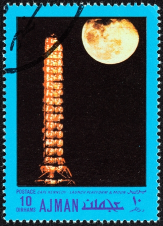 cape canaveral: AJMAN EMIRATE - CIRCA 1970  A stamp printed in United Arab Emirates from the  Space exploration  issue shows Cape Kennedy, launch platform and moon, circa 1970