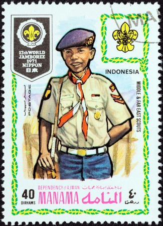 dependency: MANAMA DEPENDENCY - CIRCA 1971  A stamp printed in United Arab Emirates from the  13th World Jamboree of the Boy Scouts in Japan  issue shows boy scout from Indonesia, circa 1971   Editorial