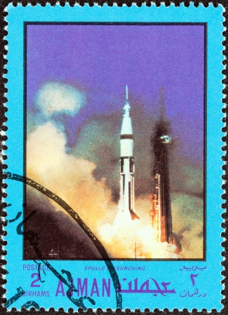 united arab emirate: AJMAN EMIRATE - CIRCA 1970  A stamp printed in United Arab Emirates from the  Space exploration  issue shows Apollo VII launching, circa 1970