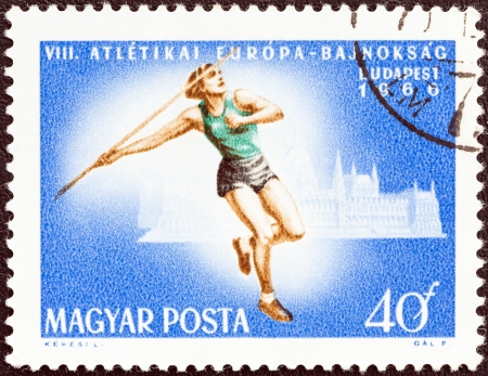 javelin throw: HUNGARY - CIRCA 1966  A stamp printed in Hungary from the  8th European Athletic Championships, Budapest  issue shows Javelin throw, circa 1966