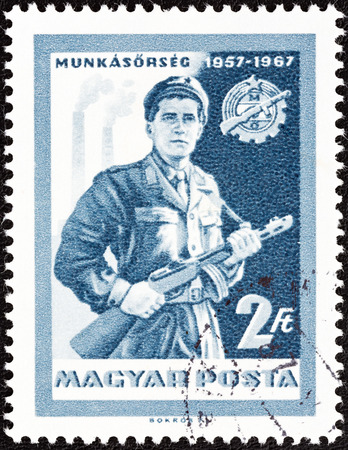 militia: HUNGARY - CIRCA 1967  A stamp printed in Hungary issued for the 10th anniversary of Workers  Militia shows Militiaman, circa 1967   Editorial