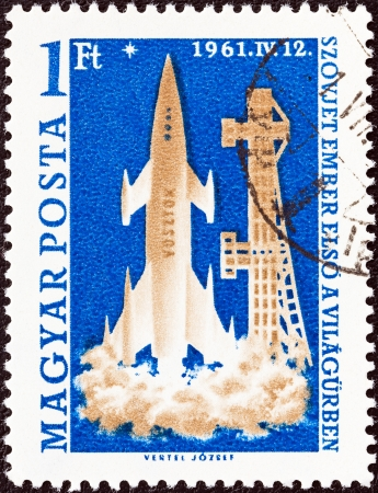 magyar: HUNGARY - CIRCA 1961  A stamp printed in Hungary from the  World s First Manned Space Flight  issue shows launching of Rocket Vostok, circa 1961