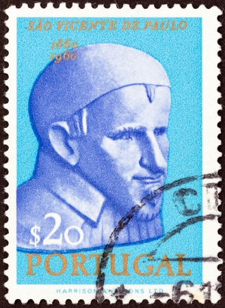 PORTUGAL - CIRCA 1963  A stamp printed in Portugal issued for the 300th death anniversary of St  Vincent de Paul shows St  Vincent de Paul, circa 1963