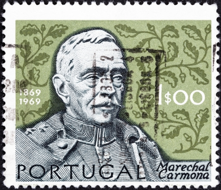 PORTUGAL - CIRCA 1969  A stamp printed in Portugal issued for his 100th birth anniversary shows Marshal Carmona and oak leaves, circa 1969