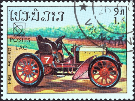 upu: LAOS - CIRCA 1984  A stamp printed in Laos from the  19th UPU Congress, Hamburg  Classic sport and race cars  issue shows Daimler, circa 1984