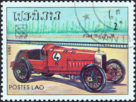 estampilla: LAOS - CIRCA 1984  A stamp printed in Laos from the  19th UPU Congress, Hamburg  Classic sport and race cars  issue shows Fiat S 57 14B, circa 1984   Editorial