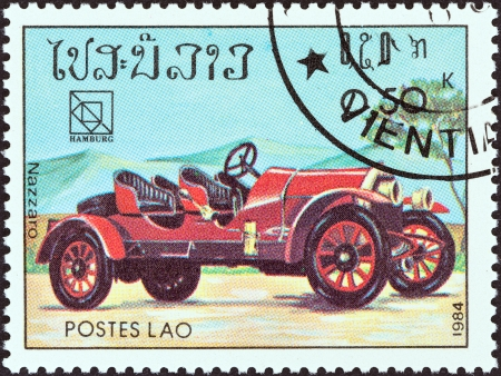 upu: LAOS - CIRCA 1984  A stamp printed in Laos from the  19th UPU Congress, Hamburg  Classic sport and race cars  issue shows Nazzaro, circa 1984