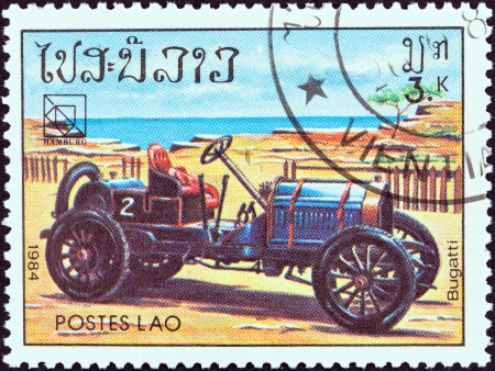 upu: LAOS - CIRCA 1984  A stamp printed in Laos from the  19th UPU Congress, Hamburg  Classic sport and race cars  issue shows Bugatti, circa 1984