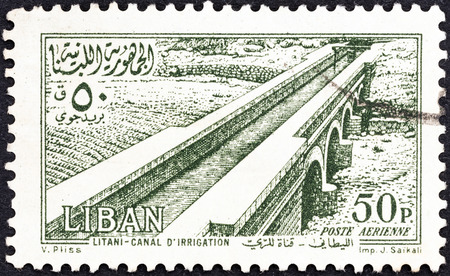 libani: LEBANON - CIRCA 1954  A stamp printed in Lebanon shows Litani Irrigation Canal, circa 1954
