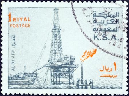 SAUDI ARABIA - CIRCA 1976  A stamp printed in Saudi Arabia shows Oil Rig, Al-Khafji, circa 1976