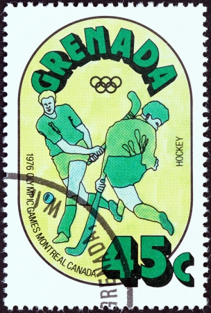 stempel: GRENADA - CIRCA 1976  A stamp printed in Grenada from the  Olympic Games, Montreal   issue shows Hockey, circa 1976