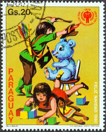 PARAGUAY - CIRCA 1980  A stamp printed in Paraguay from the  Christmas, International Year of the Child  issue shows Children playing with toys, circa 1980