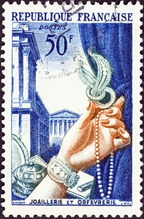 postes: FRANCE - CIRCA 1953  A stamp printed in France from the  Literary Figures and National Industries  issue shows Gold plate and jewellery, circa 1953