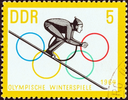 commencing: GERMAN DEMOCRATIC REPUBLIC - CIRCA 1963  A stamp printed in Germany from the  Winter Olympic Games, Innsbruck, 1964  issue shows Ski Jumper commencing Run, circa 1963