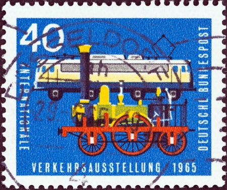 bundes: GERMANY - CIRCA 1965  A stamp printed in Germany from the  International Transport Exhibition, Munich  issue shows Locomotive Adler  1835  and Class E 10 12 electric locomotive  1960s , circa 1965   Editorial