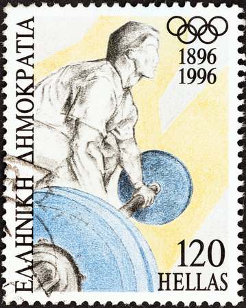 olympiad: GREECE - CIRCA 1996  A stamp printed in Greece from the  Modern Olympic games centenary  issue shows a weightlifter, circa 1996   Editorial