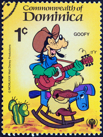 stempel: DOMINICA - CIRCA 1979  A stamp printed in Dominica from the  International Year of the Child  Walt Disney Cartoon Characters   issue shows Goofy playing guitar, circa 1979
