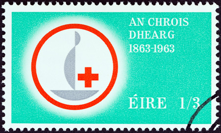 stempel: IRELAND - CIRCA 1963  A stamp printed in Ireland issued for the Centenary of Red Cross shows Centenary Emblem, circa 1963   Editorial