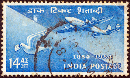 indian postal stamp: INDIA - CIRCA 1954  A stamp printed in India issued for the Indian Stamp Centenary shows Postal Transport of 1854 and 1954, circa 1954  Editorial
