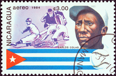 NICARAGUA - CIRCA 1984  A stamp printed in Nicaragua from the  History of Baseball  Portraits and national colors  issue shows Carlos Colas, Cuba, circa 1984