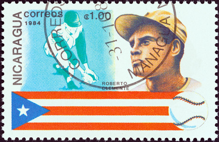 NICARAGUA - CIRCA 1984  A stamp printed in Nicaragua from the  History of Baseball  Portraits and national colors  issue shows Roberto Clemente, Puerto Rico, circa 1984