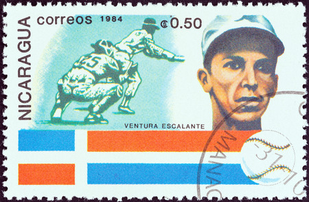 NICARAGUA - CIRCA 1984  A stamp printed in Nicaragua from the  History of Baseball  Portraits and national colors  issue shows Ventura Escalante, Dominican Republic, circa 1984