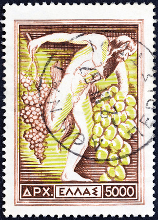 GREECE - CIRCA 1953  A stamp printed in Greece from the  National Products  issue shows Grapes  God Dionysus holding grapes , circa 1953