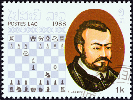 timbre: LAOS - CIRCA 1988  A stamp printed in Laos from the  Chess Masters   issue shows Ruy Lopez Segura, circa 1988