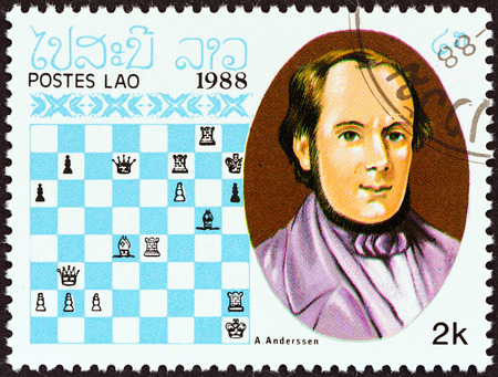 estampilla: LAOS - CIRCA 1988  A stamp printed in Laos from the  Chess Masters   issue shows Adolf Anderssen, circa 1988  Editorial