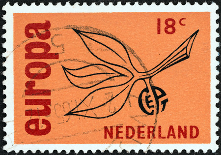 orange nassau: NETHERLANDS - CIRCA 1965  A stamp printed in the Netherlands from the  Europa  issue shows Europa Sprig, circa 1965