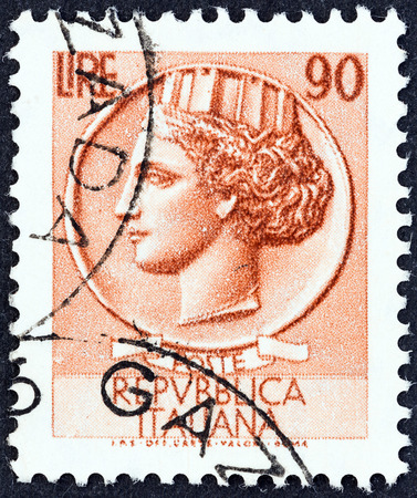 turreted: ITALY - CIRCA 1958  A stamp printed in Italy from the  Italy turreted  Syracuse   issue shows an Ancient coin of Syracuse, circa 1958  Editorial