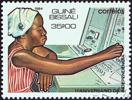 telephonist: GUINEA-BISSAU - CIRCA 1984  A stamp printed in Guinea-Bissau from the  11th anniversary of Independence  issue shows telephonist and switchboard, circa 1984
