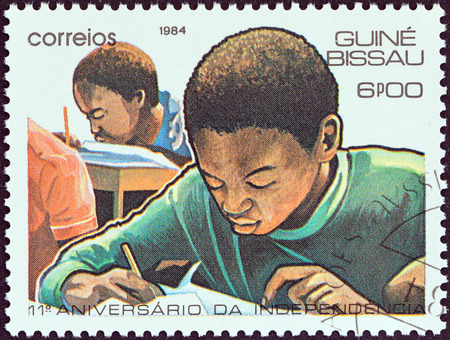 GUINEA-BISSAU - CIRCA 1984  A stamp printed in Guinea-Bissau from the  11th anniversary of Independence  issue shows children in school, circa 1984
