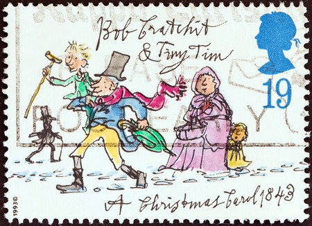 UNITED KINGDOM - CIRCA 1993  A stamp printed in United Kingdom from the  Christmas  150th anniversary of A Christmas Carol novel by Charles Dickens  issue shows Bob Cratchit and Tiny Tim, circa 1993